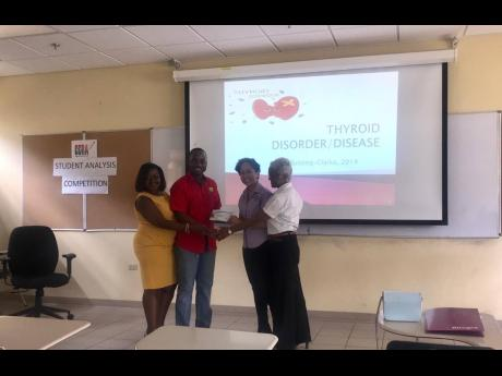 The Pharmaceutical Society of Jamaica (PSJ) presents a checque for $500,000, proceeds of its 5K race to directors of the Jamaica Kidney Kids Foundation on March 10. From left: Dr Ernestine Watson, president, PSJ; Okeeno McLeod, executive member, PSJ; Erin Hayle, coordinator, Jamaica Kidney Kids Foundation; and Dr Maolynne Miller, founder and chairperson, Jamaica Kidney Kids Foundation.