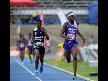 Tarees Rhoden of Kingston College (right) holds on to finish just ahead of Jamaica College athlete J'Voughnn Blake in the Boys Class One 1500m at the Youngster Goldsmith meet held at the National Stadium on February 2, 2018.