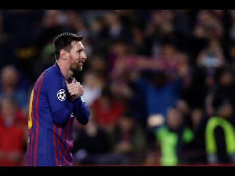 Barcelona forward Lionel Messi celebrates after scoring his team's opening goal from the penalty spot during the Champions League round of 16, second leg match between FC Barcelona and Olympique Lyon at the Camp Nou stadium in Barcelona, Spain on Wednesday, March 13.