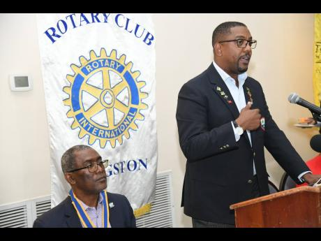 Dave Cameron, president of Cricket West Indies, speaking at a KIngston Rotary Club luncheon at The Jamaica Pegasus hotel last Thursday. At left is Linval Freeman, president of the club.