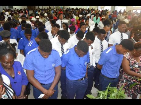 Members of the Jamaica College track and field team attend a church service at the Faith Cathedral Deliverance Centre in St Andrew yesterday. The team was seeking blessing from God in attempt to win their first ISSA/GraceKennedy Boys' Athletics Championships trophy since 2011.
