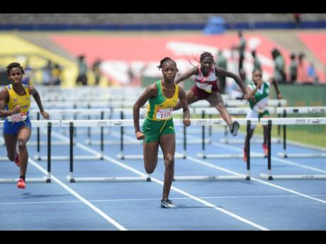 Jadea Mitchell (1174) of St Jago wins her girls 70m hurdles Class 4 heat at the ISSA/GraceKennedy Boys and Girls Athletics Championships at the National Stadium.