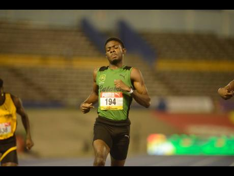Shorn Hector/Photographer Calabar's Christopher Taylor crosses the line in front in the Class One Boys 200m heats at the ISSA/GraceKennedy Boys and Girls Athletics Championships at the National Stadium last night.