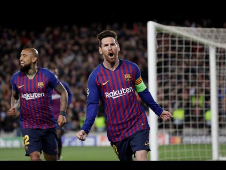 Barcelona's Lionel Messi (right) celebrates after scoring his side's third goal during the Champions League round-of-16 second leg match between FC Barcelona and Olympique Lyon at the Camp Nou stadium in Barcelona, Spain, recently.