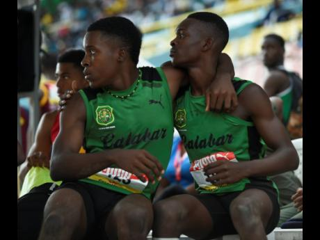 Luke Brown of Calabar (left) celebrates his seilver medal jump of 7.45m with team-mate Jordan Turner, who placed first in the Class Two boys long jump with a distance of 7.46m at the ISSA/GraceKennedy Boys and Girls Athletics Championships at the National Stadium in Kingston on Wednesday March 27, 2019.