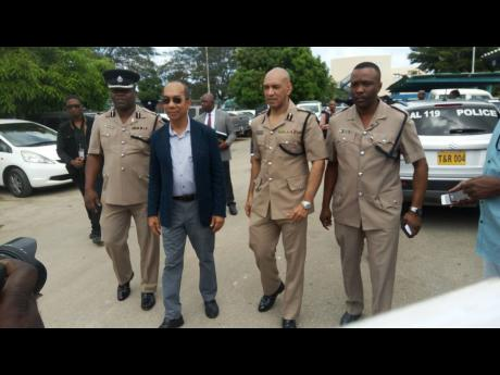 From left: Donovan Graham, assistant commissioner of police in charge of Area One; National Security Minister Dr Horace Chang; Major General Antony Anderson, commissioner of police; and Superintendent Vernon Ellis, commanding officer for St James, take part in a tour of police stations in the Area One division yesterday.