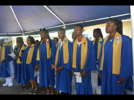Graduates of the Jamaica Social Investment Fund (JSIF) Behaviour Change Programme perform a song during the graduation ceremony held at the Family and Parenting Centre in Unity Hall, St James, on Wednesday.
