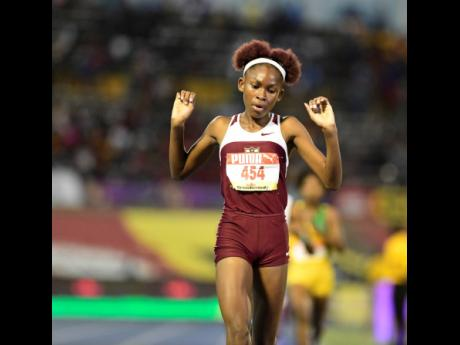Jodyann Mitchell of Holmwood Technical wins the Class Three girls' 1500m finals with a time of 4:47.07 at the ISSA/GraceKennedy Boys and Girls' Athletics Championships at the National Stadium yesterday.