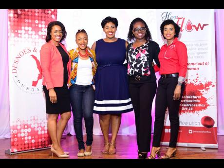 Shelly-Ann Weeks (second left), founder of the HERFlow Foundation, poses with Desnoes and Geddes Foundation members (from left) Jacqueline Cameron, Stacy-Ann Smith, Reshima Kelly and Tyheissa Williams. The foundations collaborated to present the Writing HERStory Conference to promote youth empowerment, menstrual education and personal development for more than 100 girls.