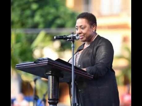 Culture and Entertainment Minister Olivia 'Babsy' Grange addressing the audience at the unveiling of Jimmy Cliff Boulevard at a ceremony held at the Old Hospital Park in Montego Bay.