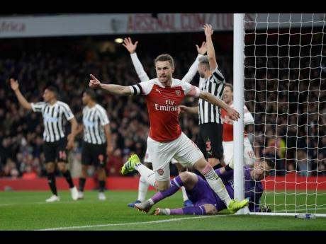 Arsenal's Aaron Ramsey celebrates before realising that his goal was disallowed during their English Premier League match against Newcastle United at the Emirates Stadium in London, England, yesterday.