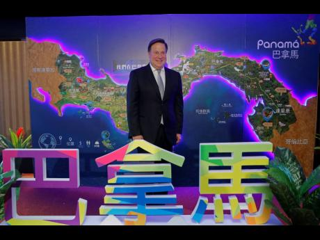Panama President Juan Carlos Varela Rodríguez poses for photographers before a conference on the Panama invest in Hong Kong, Tuesday, April 2, 2019.