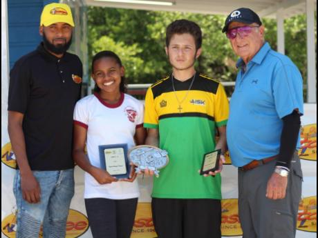 Defending champions of the Tastee Inter-School Sporting Clay Challenge Savannah Miller (second left) and Peter Mahfood (second right) pose with Alessandro Boyd (left) of title sponsor Tastee and national coach Khaleel Azan on Sunday at the Jamaica Skeet Club in Portmore. Hillel Academy also defended their team title, winning ahead of AISK and Campion College.