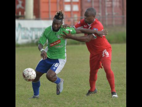 Former Montego Bay United striker Owayne Gordon (left) tries to get past Wayne Ellis from Boys' Town during a Red Stripe Premier League football match at the Barbican Field in Kingston last January. Gordon now plies his trade for Oklahoma City Energy in the USL Championships.