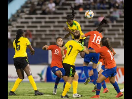 Jamaican striker Khadija Shaw (top) gets high to head to goal during the first international friendly against Chile at the National Stadium on Thursday, February 28, 2019. The Reggae Girlz won 1-0. File