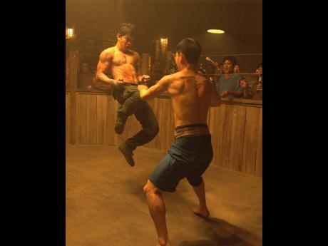 Tiger Hu Chen and IkoUwais in 'Triple Threat' (2019).