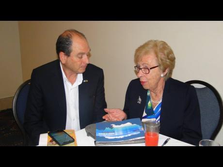 Holocaust survivor Eva Schloss chatting with Israeli ambassador to Jamaica, Danny Barin, at The Jamaica Pagasus on Tuesday, April 2.