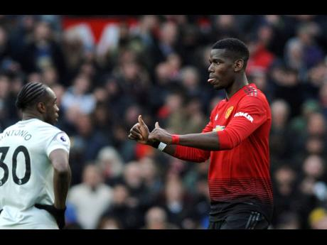 Manchester United's Paul Pogba gestures after scoring his side's second goal during the English Premier League match against West Ham United at Old Trafford yesterday. Manchester United won 2-1.