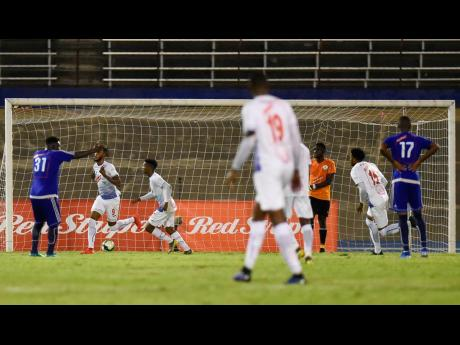 Roshane Sharpe of Portmore United (second from left) celebrates his goal scored minutes before the final whistle, securing Portmore United's win in the Red Stripe Premier League first-leg semi-final game against Mount Pleasant FA at the National Stadium last Monday.
