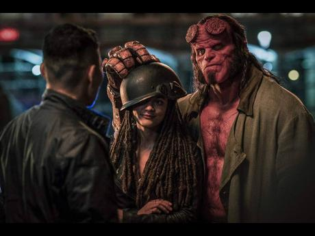 David Harbour and Sasha Lane in a scene from 'Hellboy'.