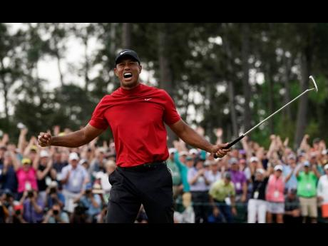 Tiger Woods is overcome with emotion after winning the Masters golf tournament in Augusta, Georgia, yesterday.