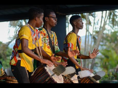 Ardenne High performs 'Sabunyuma' in the Drums Ensemble, Non-Jamaican Rythm section of the JCDC Drum Fest on day three of the Music National Finals, held at the Louise Bennett Garden Theatre on Sunday.