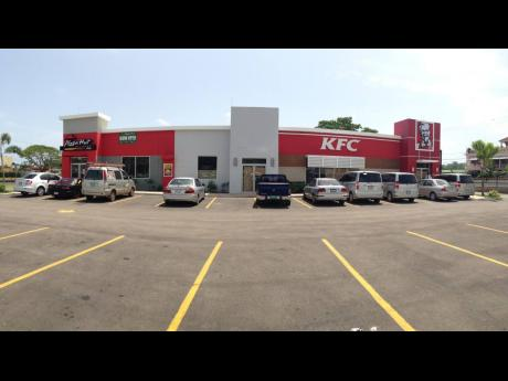 KFC and Pizza Hut restaurants in Ocho Rios. Franchise operator Restuarant of Jamaica will be rolling out at least seven new restaurants for the two brands over three years.
