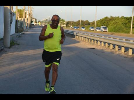 Businessman Howard Ward takes a morning jog in Montego Bay, St James last week. The businessman was severely injured in a vehicular crash a little more than a month ago.