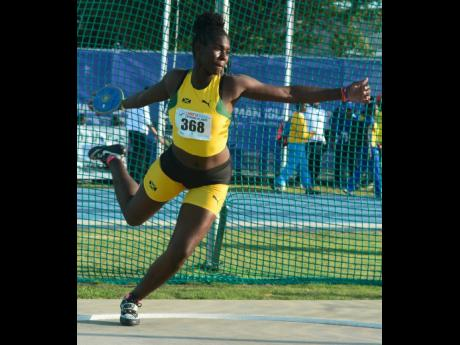 Jamaica's Cedricka Williams breaks the Under-17 girls discus throw record with a heave of 47.94m on the third and final day at the Carifta Games in the Cayman Islands yesterday. Collin Reid photo courtesy of Courts Jamaica, Guardian Life, Supreme Ventures and Alliance Investments.