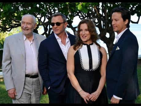 Daniel Craig (second left) with the production team of (from left) Michael G. Wilson, Barbara Broccoli, and Cary Joji Fukunaga.