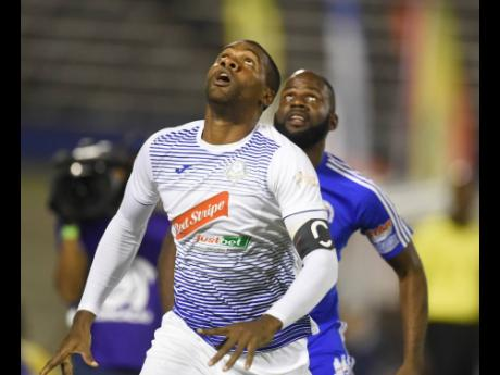 Portmore United captain Rosario Harriott (front) in action against Mount Pleasant FA during their second-leg Red Stripe Premier League semi-final, played at the National Stadium in Kingston on Monday, April 15.