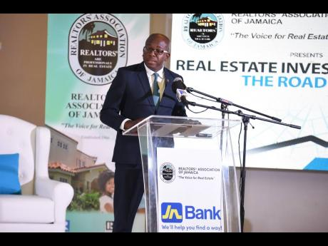Minister with responsibility for housing, water and infrastructure in the Ministry of Economic Growth and Job Creation, Senator Pearnel Charles Jr, speaking during a symposium organised by the Realtors' Association of Jamaica in partnership with JN Bank. The event was held at the Montego Bay Convention Centre in Rose Hall, St James.