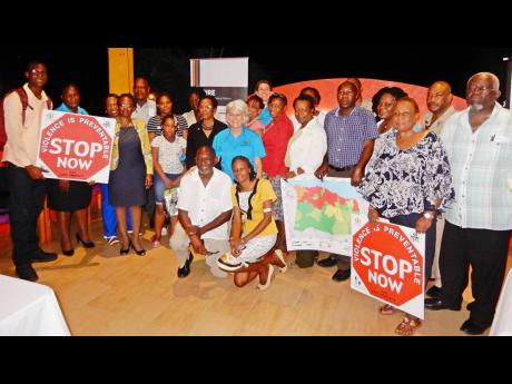 Dr Elizabeth Ward (centre), head of the Violence Prevention Alliance (VPA), along with persons who attended the VPA launch in St Ann.