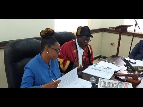 Chief Executive Officer of the Portland Municipal Corporation, Jennifer Brown-Cunningham, and Mayor of Port Antonio Paul Thompson.