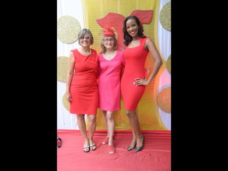 Royally red beauties: Thalia Lyn, chief executive officer of Island Grill, is sandwiched by Debra Chen (left), executive director of Heart Foundation, and the new Go Red brand ambassador for the Heart Foundation, Dr Sarah Lawrence.