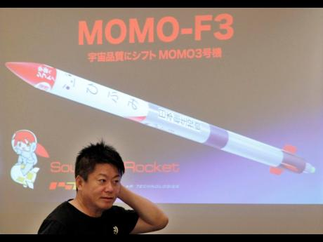 Japanese entrepreneur and founder of Interstellar Technologies Inc. Takafumi Horie speaks during a press conference in Tokyo, Wednesday, May 15, 2019. Horie said a low-cost rocket business in Japan is well-positioned to accommodate scientific and commercial needs in Asia. While Japan's government-led space programs have demonstrated top-level technology, he said that the country has fallen behind commercially due to high costs.