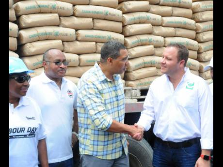 From left: Olivia Grange, minister of culture, gender, entertainment and sport; Major Clive Davis, director general of the Office of Disaster Preparedness and Emergency Management; Prime Minister Andrew Holness and Peter Donkersloot, general manager of Carib Cement, at the 2018 donation of 3,000 bags of cement to Labour Day and national disaster-recovery efforts.
