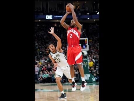 Toronto Raptors' Kawhi Leonard (right) shoots in front of Milwaukee Bucks' Malcolm Brogdon during the second half of Game 5 of the NBA Eastern Conference basketball play-off finals on Thursday, May 23, 2019, in Milwaukee. The Raptors won 105-99 to take a 3-2 lead in the series.