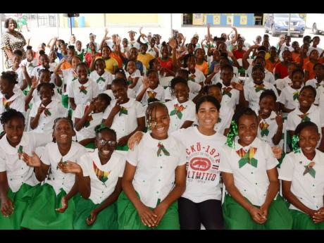 Zuriel Oduwole poses with Mona Heights Primary School students. The girls, most between ages nine and 12, enjoyed sharing their career goals, which ranged from becoming lawyers, doctors, and teachers to entrepreneurs, police officers, chefs, and astronauts.