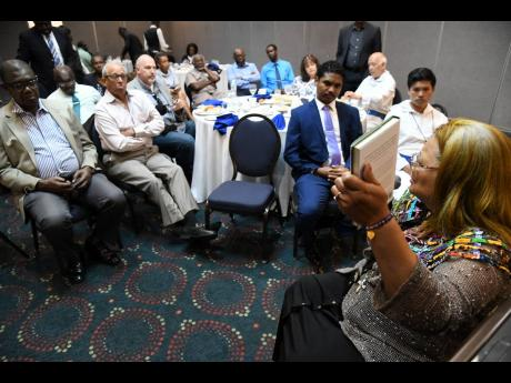 Dr Alveda King (right), niece of the Reverend Dr Martin Luther King Jr and international advocate for human rights of the child, delivers a pro-life message to 50 church leaders at a breakfast meeting at The Jamaica Pegasus hotel in New Kingston yesterday.