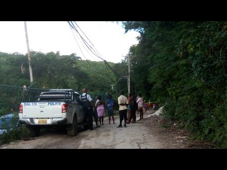 The secluded section of Brandon Hill near downtown Montego Bay, where the body of the missing taxi operator, Horace Roseway, was found.