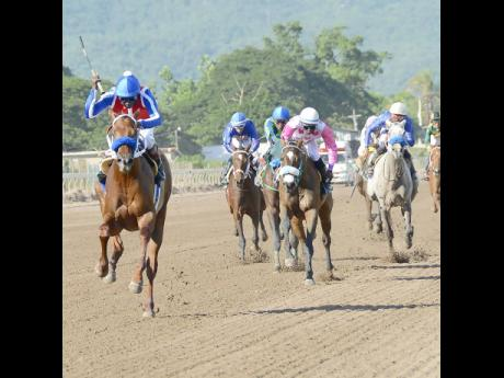 Supreme Soul (left), ridden by Shane Ellis, charges to victory in the Andrew H.B. Aguilar Memorial Cup at Caymanas Park on Saturday, November 8, 2018.