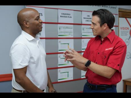 Ricardo Nuncio (right), managing director, Red Stripe, speaks with Stephen Dawkins, vice-president, Export and Logistics Committee, Jamaica Manufacturers' and Exporters' Association, at an export peer share hosted by the brewing company.