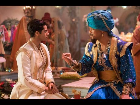 Aladdin stars Mena Massoud (left) and Will Smith.