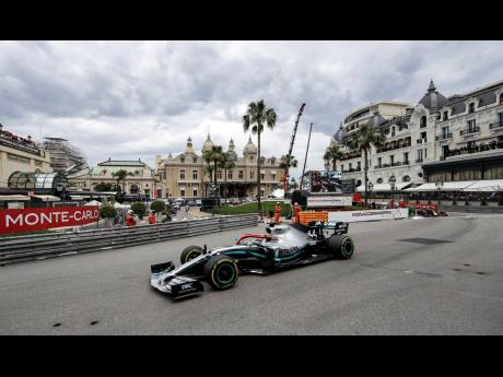 Leading Mercedes driver Lewis Hamilton of Britain out in front during the Monaco Formula One Grand Prix race at the Monaco racetrack yesterday.