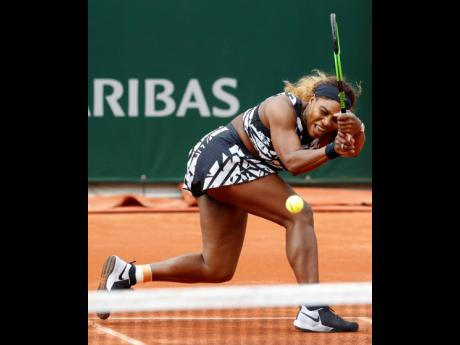 Serena Williams plays a shot against Vitalia Diatchenko during their first-round match of the French Open at the Roland Garros Stadium in Paris yesterday.