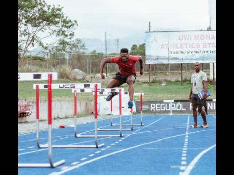Racers Track Club sprint hurdler Michael O'Hara being put through his drills by coach Gregory Little at their training base at The UWI Mona/Usain Bolt Track on Wednesday, April 17.