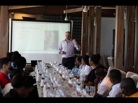 Team members from Sandals Montego Bay pay keen attention as Constellation Brands' Master of Wine, Mark de Vere, briefs them on the objectives of the training session. One of less than 400 Masters of Wine in the world, de Vere walked the team members through the history of wine, types of wine and various selling points and stories for each varietal,  before taking them on a tasting journey of a few new and existing wines on the company's wine list.