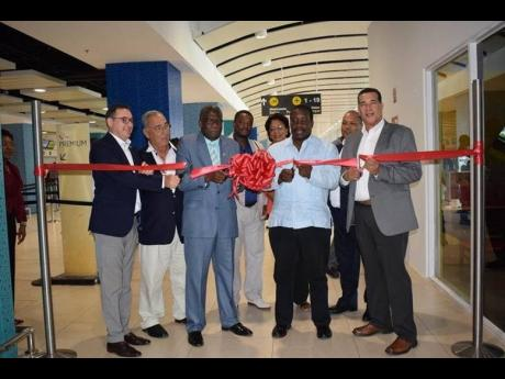 Directors on the Board of the AAJ: Rafael Echevarne (CEO MBJ) William Shagoury, Custos of Clarendon & Chairman AAJ; Honourable Minister of Transport and Mining Robert Montague; His Worship Councillor Homer Davis, Mayor of Montego Bay; Councillor Heroy Clarke; Fay Hutchinson. Audley Deidrick (president & CEO, AAJ) is pictured in the background.