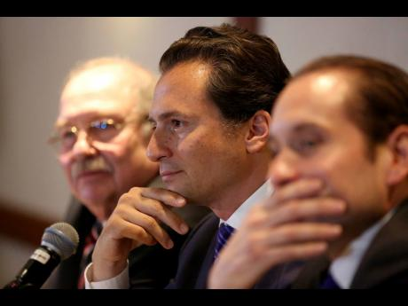 Former head of Mexico's state-owned oil company Pemex Emilio Lozoya, at centre.